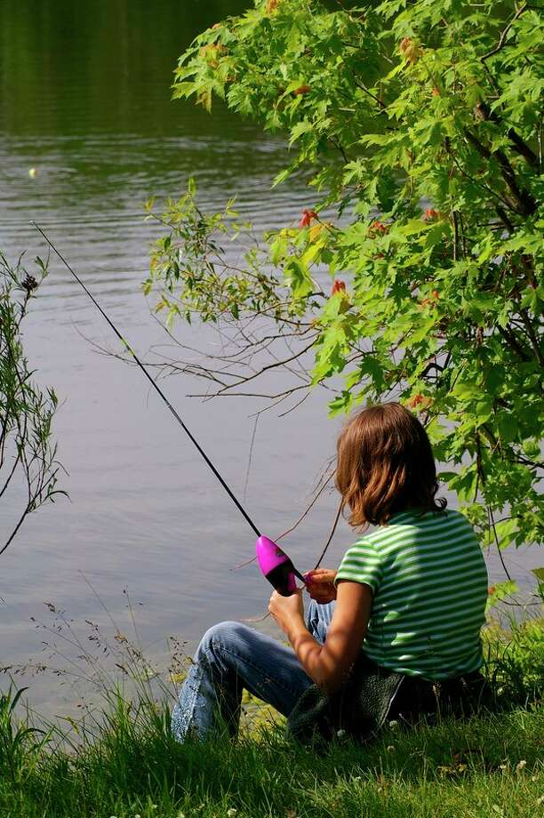 Often, keeping a fish for a meal is part of the allure of the sport, for anglers young and old. This photo was taken at Lake Kiwassee at Stratford Woods Park years ago. (Steve Griffin file photo/Hearst Michigan)