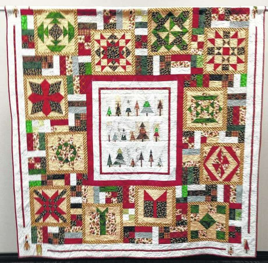 "The River Country Quilt Show's raffle quilt, ""Christmas in July,"" was made using challenge blocks from the 2017 show. There were enough blocks submitted for the challenge that it became a reversible quilt, with another design on the back side. Photo:       Photo Provided"