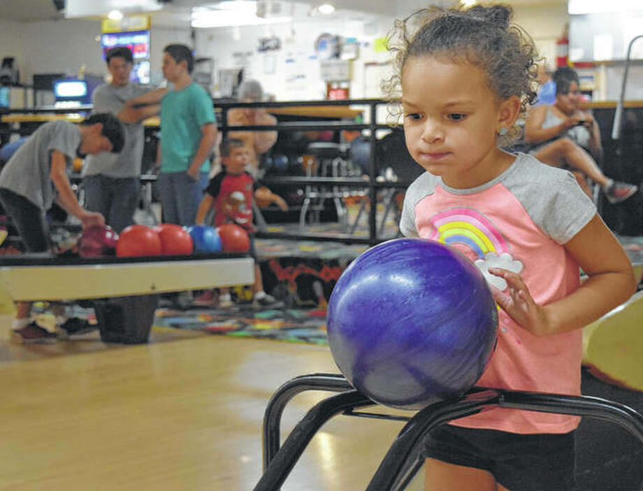 Averie Moor, 5, of Jacksonville, the daughter of Johnnie and Rita Moore, prepares to knock down pins at the Bowl Inn for the Kids Bowl Free program. Children can get two free games every Wednesday, Thursday and Friday. Registration is required at kidsbowlfree.com.