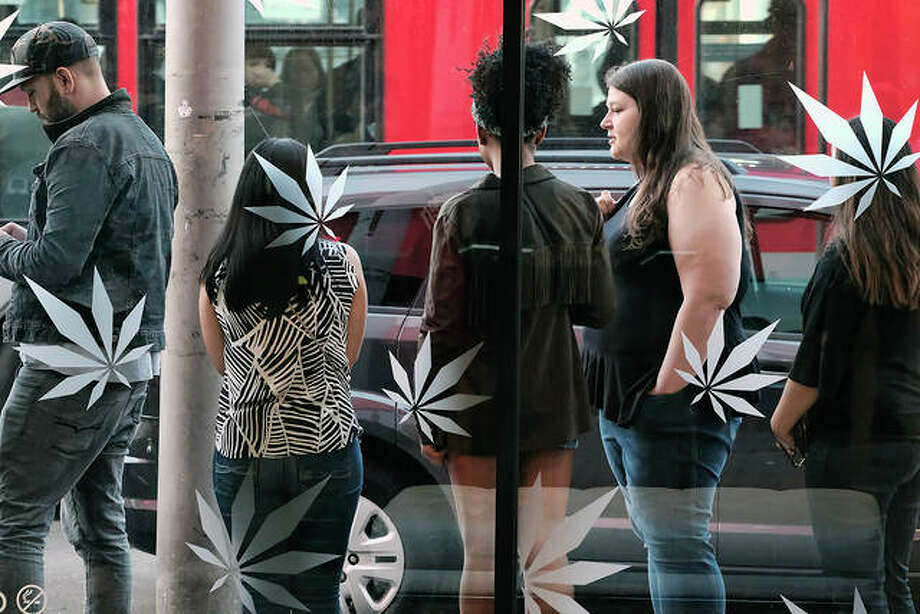 Customers line up for recreational marijuana outside of MedMen a dispensary in West Hollywood, California. U.S.-based marijuana businesses are lining up to list on the Canadian Securities Exchange to tap into financing from institutional investors put off by the U.S. ban on pot. Bastions of America's marijuana industry like MedMen, Green Thumb Industries, Acreage Holdings and Canna-Hub have recently gone public in Canada or are planning to do so to get access to foreign markets and the money they need to grow. Photo:       Richard Vogel | AP