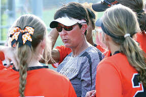 Edwardsville coach Lori Blade (center) is the 2018 Telegraph Large-Schools Softball Coach of the Year after guiding the Tigers to a 22-4 season that included SWC and Class 4A regional championships.