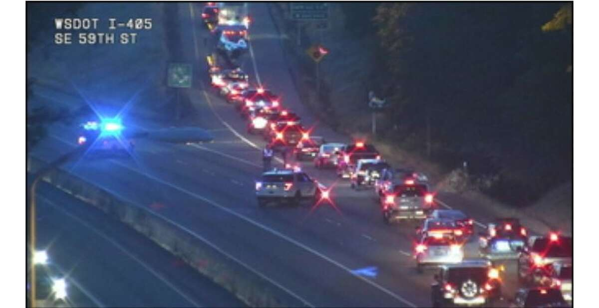 Northbound Interstate 405 traffic Thursday morning after two Bellevue police officers were involved in a crash.