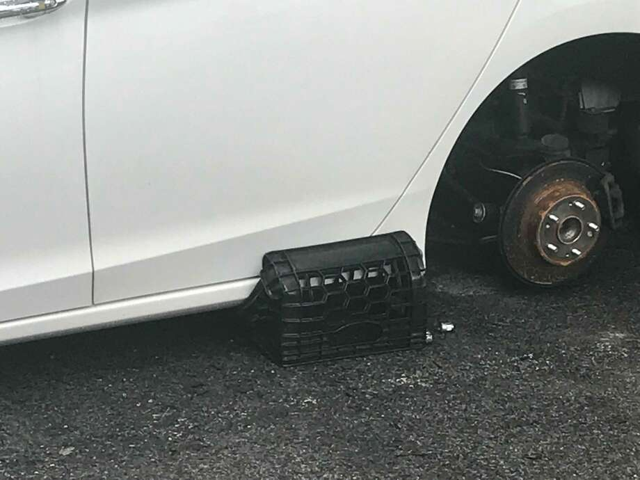 Stamford police are investigating the theft of wheels and tires off one vehicle and the break-ins of seven others at a new residential complex on Glenbrook Road early Thursday July 26, 2018. Police also turned up another vehicle parked at an office building on Summer Street that had two of its tires stolen and replaced with milk crates that may be related. Photo: John Nickerson /Hearst Connecticut Media