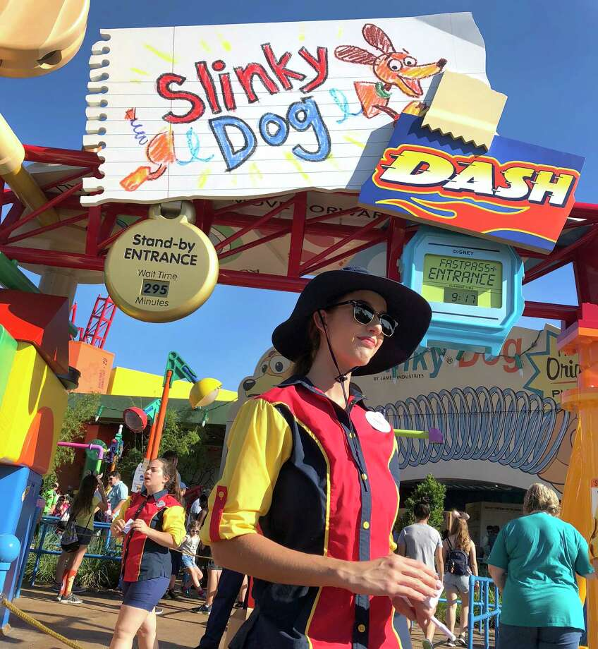 The standby entrance at the Slinky Dog Dash on a recent summer afternoon featured a posted wait time of 295 minutes. Photo: Washington Post Photo By Steve Hendrix. / The Washington Post