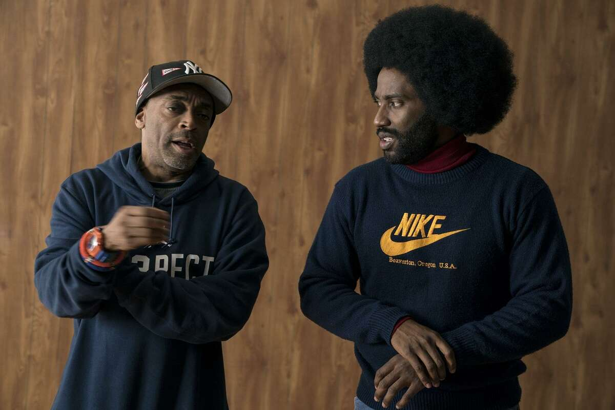 "Director Spike Lee (left) and actor John David Washington on the set of ""BlacKkKlansman."""