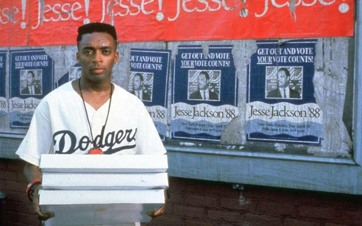 """Spike Lee is Mookie in a scene from his 1989 film """"Do The Right Thing,"""" which he also directed, wrote and produced. It was Lee's first masterpiece."""