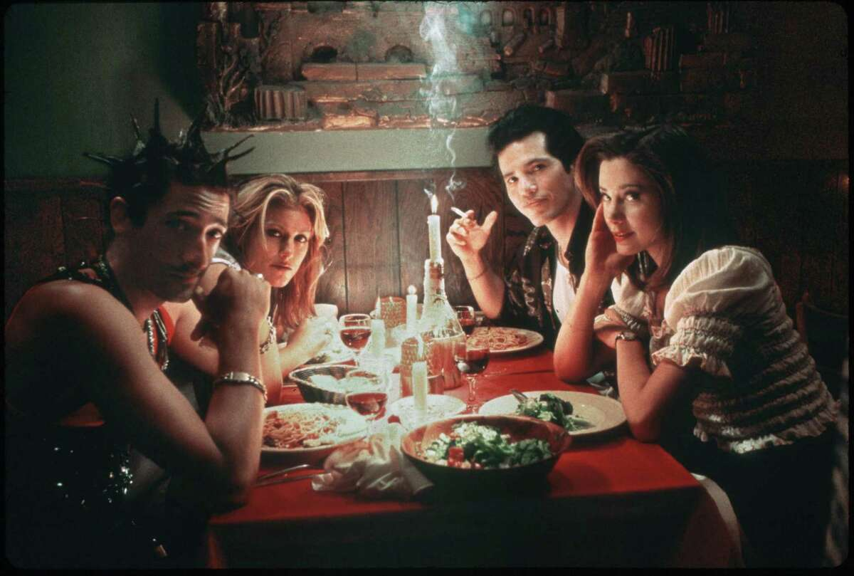 SUMMER OF SAM - (l-r): Adrien Brody, Jennifer Esposito, John Leguizamo, Mira Sorvino. HOUCHRON CAPTION (07/02/1999): As serial killer Son of Sam terrorizes New York City, four friends from the Bronx, from left, Ritchie (Adrien Brody), Ruby (Jennifer Esposito), Vinny (John Leguizamo) and Dionna (Mira Sorvino), find their relationships tested by pressure, infidelity and paranoia in ``Summer of Sam''.