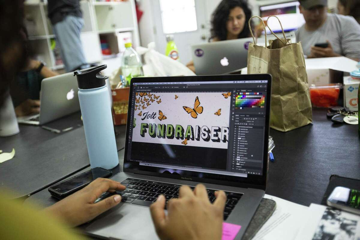 Volunteer Edith Valle, 24, works on an email banner during volunteer hours at the Jolt Texas office on July 24, 2018 in Austin, Texas.