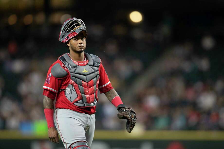 Los Angeles Angels catcher Martin Maldonado walks off the field during a baseball game against the Seattle Mariners, Thursday, July 5, 2018, in Seattle. The Mariners won the game 4-1. Houston acquired Angels catcher Martin Maldonado on Thursday in exchange for minor league pitcher Patrick Sandoval and international bonus pool money. (AP Photo/Stephen Brashear) Photo: Stephen Brashear, Associated Press / FR159797 AP