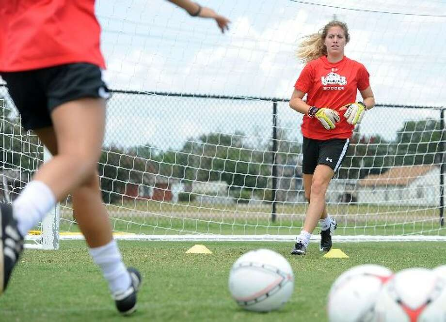 Lamar's Lauren Lovejoy tends goal during practice at the Cardinal's field on Wednesday.