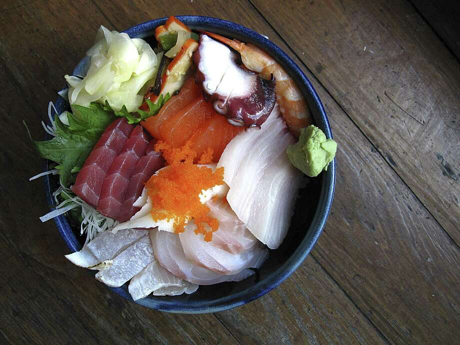 Chirashi bowl with rice, seaweed salad, squid salad, albacore, salmon, tuna, snapper, yellowtail , shrimp, octopus and tobiko from Koi Kawa. Photo: Mike Sutter /Staff Photographer