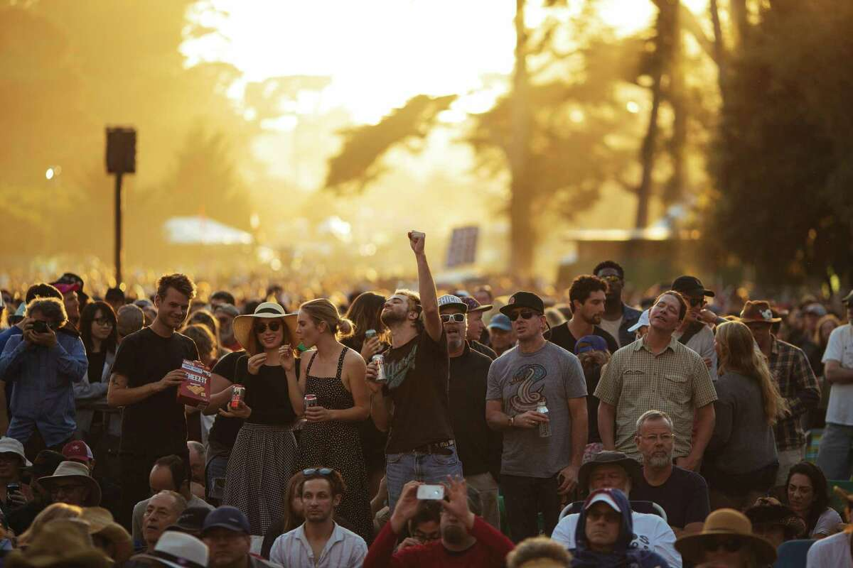 Sun light falls upon the fans during Emmylou Harris' performance at Banjo Stage during the Hardly Strictly Bluegrass in San Francisco, Calif. Sunday, October 8, 2017.