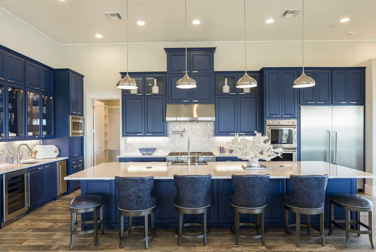 Kitchen cabinets are painted Benjamin Moore's Symphony Blue.