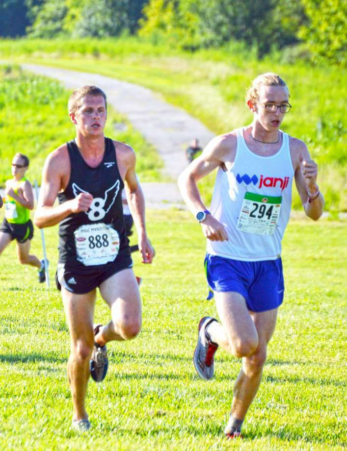 Edwardsville's Eric Johannigmeier, left, and Granite City's Andrew O'Keefe, right, compete in last year's  Mud Mountain 5K at SIUE. Photo: Matthew Kamp