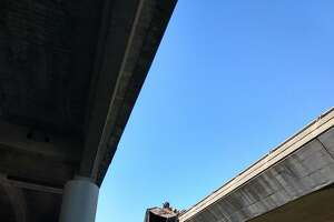 Several lanes of Southbound 101 were closed Thursday morning after an accident involving a trailer which was seen dangling over the railing near the Downtown San Rafael Park and Ride lot.