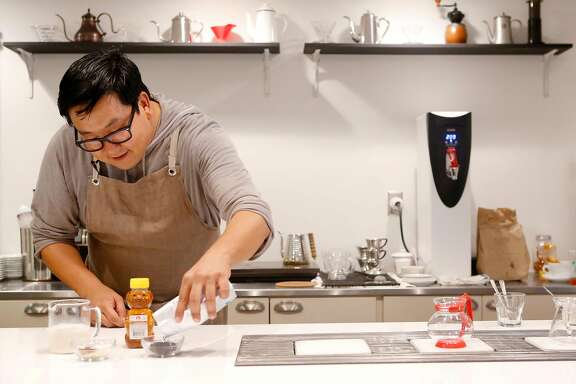 Nick Cho pours out tea to steep at Wrecking Ball Coffee in San Francisco Wednesday October 13, 2015.