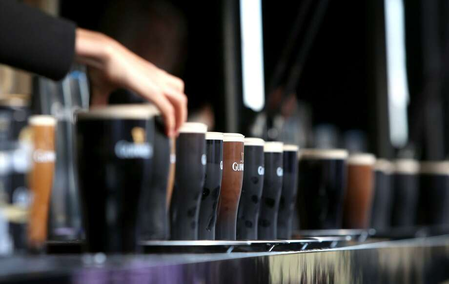 Guinness beers line a bar top in a promotional photo provided by Diageo. While Guinness sales were down 1 percent in the United States over the 12-month span ending in June 2018, Diageo is counting on the August 3 opening of a new Guinness Open Gate Brewery in Relay, Md. to reinvigorate the brand in the United States. (Image courtesy Diageo) Photo: Rosie Hallam / Rosie Hallam