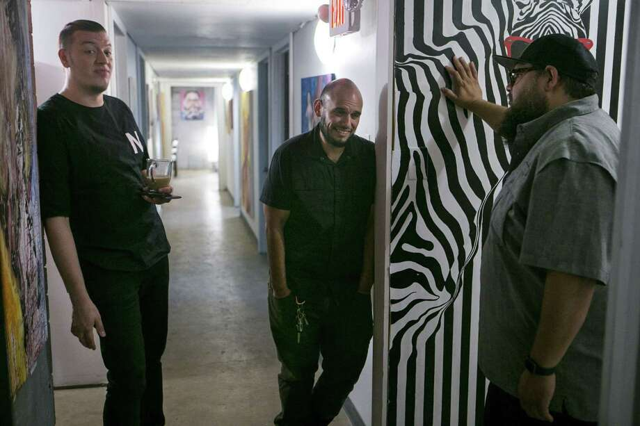 Zack Smith, Ismael Rodriguez and Richard Jemal chat in the hallway outside their respective studio spaces at The Parish, a former-church-turned-arts-complex on the West Side that hosts about 20 creatives in a dozen studios. Photo: Josie Norris /Staff Photographer / © San Antonio Express-News
