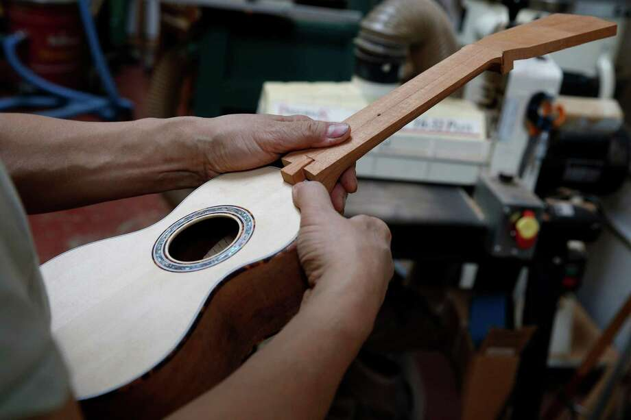 Mike DaSilva, owner of DaSilva Ukulele Co., assembles a ukelele at his workspace in Berkeley in this file photo from 2016. It takes him about a week to hand-craft one. Photo: Santiago Mejia / The Chronicle / ONLINE_YES