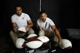 Stanford wide receiver JJ Arcega-Whiteside, left, and cornerback Alijah Holder autograph footballs at the Pac-12 Conference NCAA college football Media Day in Los Angeles, Wednesday, July 25, 2018. (AP Photo/Jae C. Hong)