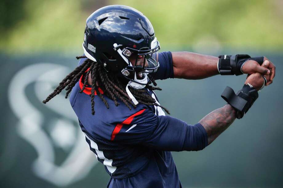"Houston Texans defensive end Jadeveon Clowney (90) makes a 'batting"" gesture as he walks onto the field during training camp at The Greenbrier Sports Performance Center on Thursday, July 26, 2018, in White Sulphur Springs, W.Va.