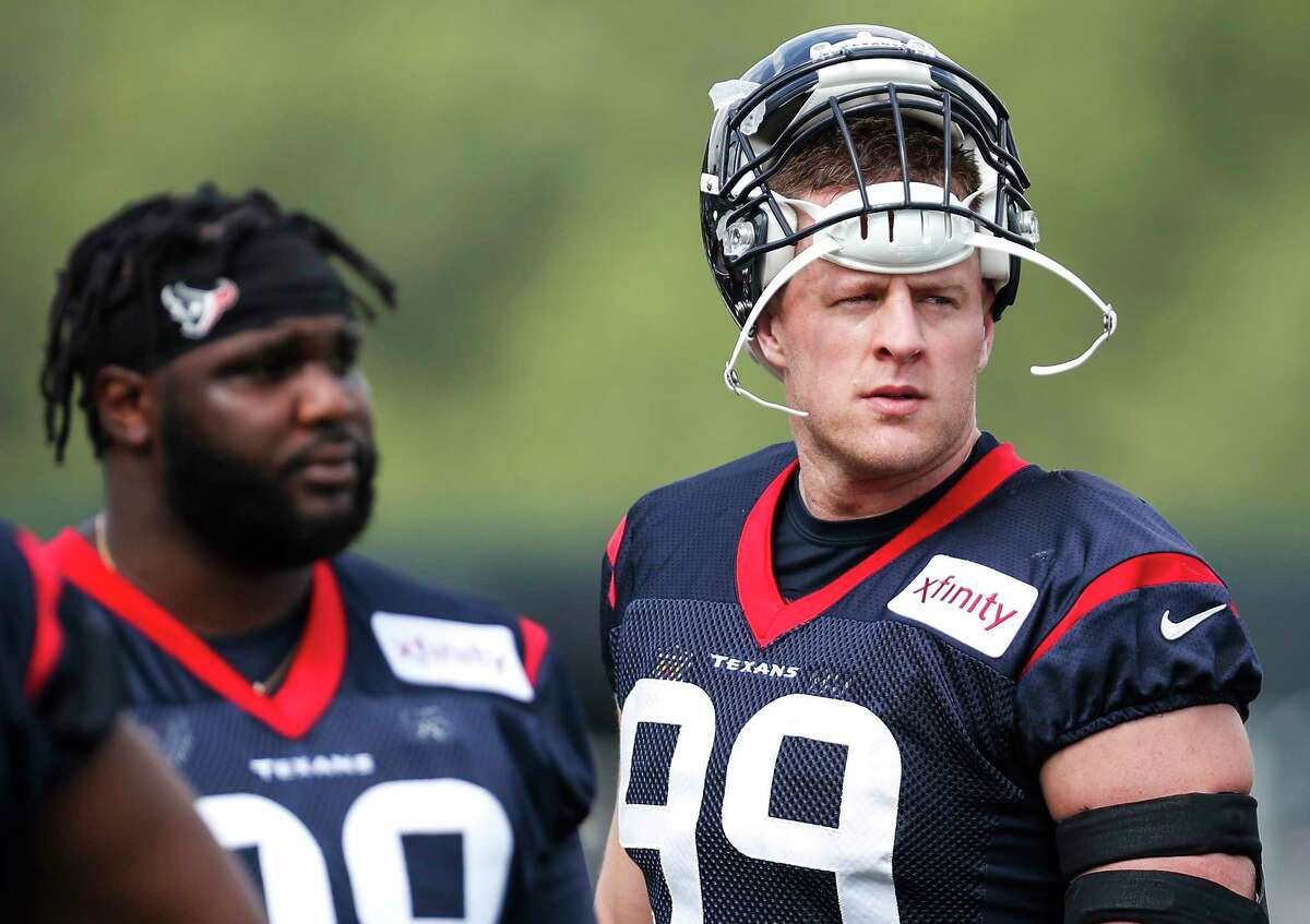 Houston Texans defensive end J.J. Watt (99) and nose tackle D.J. Reader (98) walk onto the practiced field for the first day of training camp at The Greenbrier Sports Performance Center on Thursday, July 26, 2018, in White Sulphur Springs, W.Va.