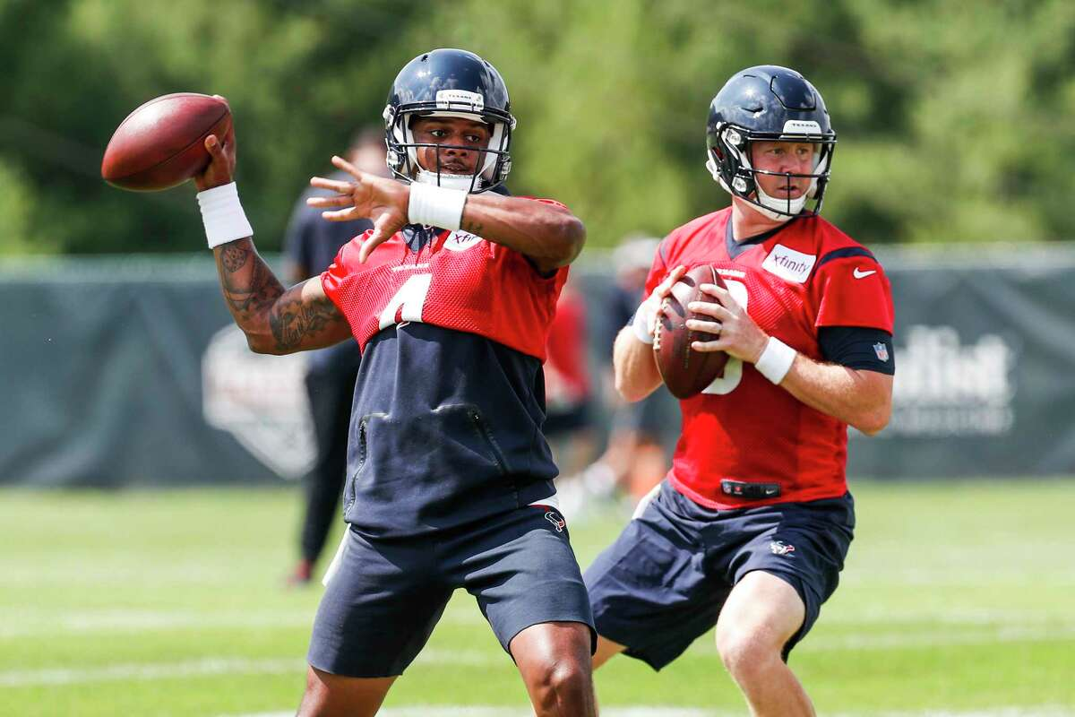 Houston Texans quarterbacks Deshaun Watson (4) and Brandon Weeden (3) drop back to pass during training camp at The Greenbrier Sports Performance Center on Thursday, July 26, 2018, in White Sulphur Springs, W.Va.