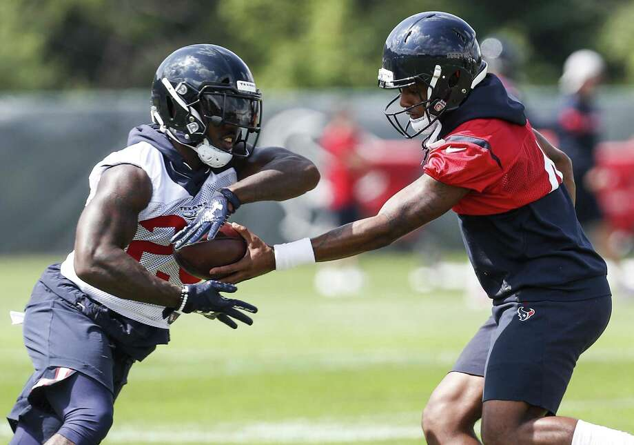 Houston Texans quarterback Deshaun Watson (4) hands the ball off to running back Lamar Miller (26) during training camp at The Greenbrier Sports Performance Center on Thursday. Photo: Brett Coomer, Staff Photographer / Houston Chronicle / © 2018 Houston Chronicle