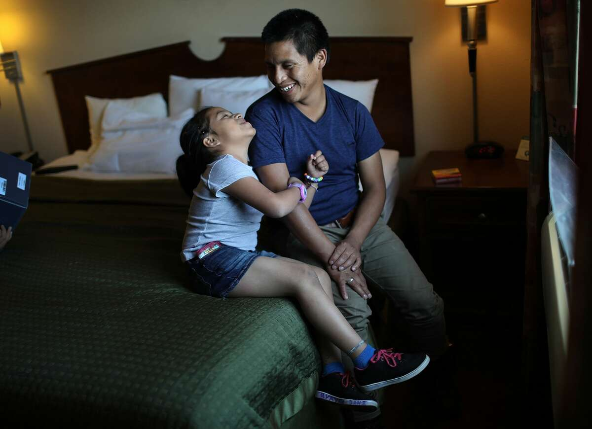 A man, identified only as Nery, and his daughter, Saylin relax together in their room as they are cared for in an Annunciation House facility after they were reunited with each other on July 25,2018in El Paso, Texas. Nery and Saylin, originally from Guatemala, were reunited at an I.C.E processing center about two months after the two were separated when they tried to cross into the United States.