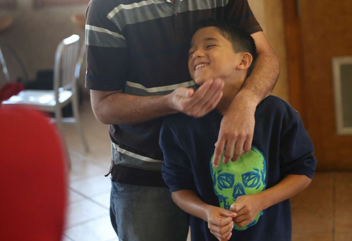 A man, identified only as Renan, spends time with his son, Nathan,11, as they are cared for in an Annunciation House facility after they were reunited with each other on July 25,2018in El Paso, Texas. Renan and Nathan, originally from Honduras, werereunitedat an I.C.E processing center about two months after the two were separated when they tried to cross into the United States.