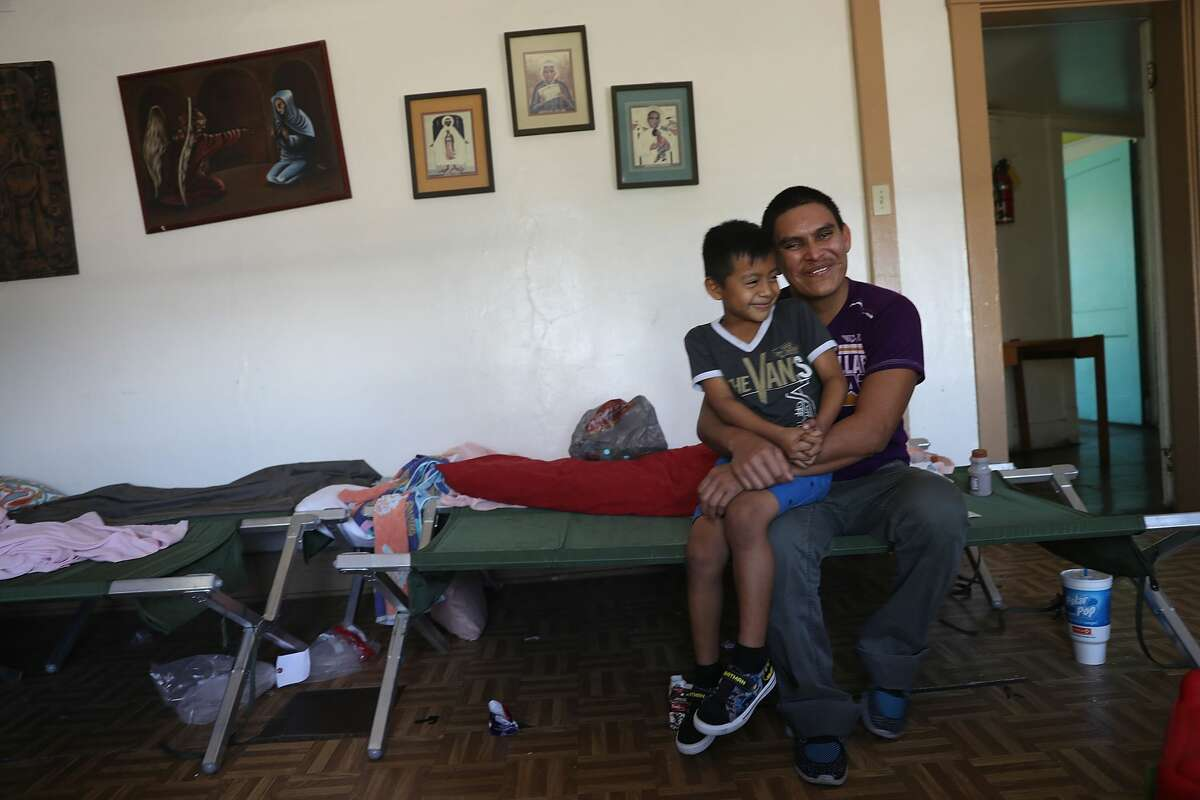 A man, identified only as Ubaldo, sits with his son Fernando, 6, as they are cared for in an Annunciation House facility after they were reunited on July 21,2018in El Paso, Texas. Ubaldo and Fernando, originally from Guatemala, werereunitedat an I.C.E processing center two months after the two were separated when they tried to cross into the United States.