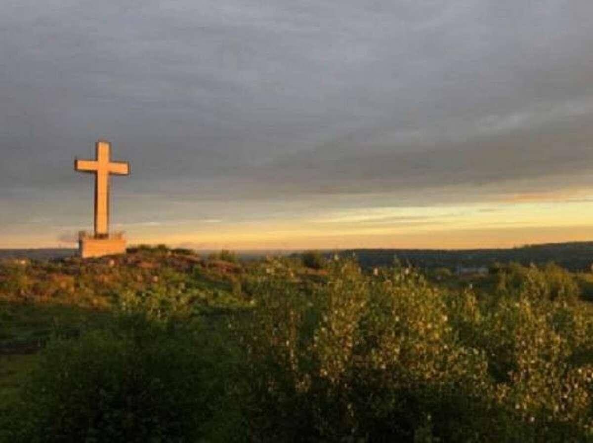 Illuminated cross at top of Holy Land USA
