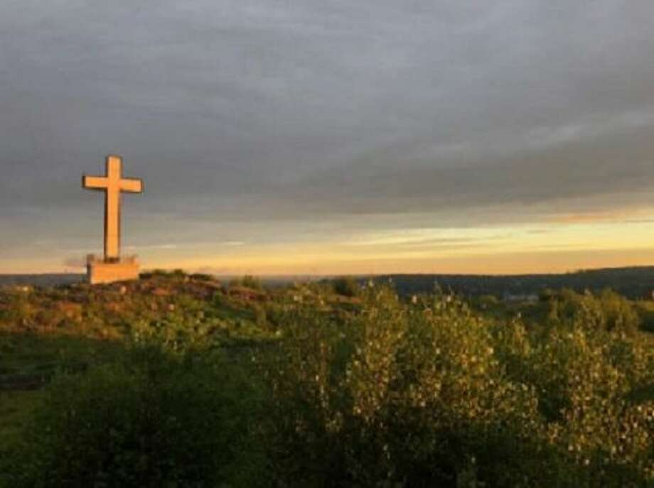 Illuminated cross at top of Holy Land USA Photo: Courtesy Photo