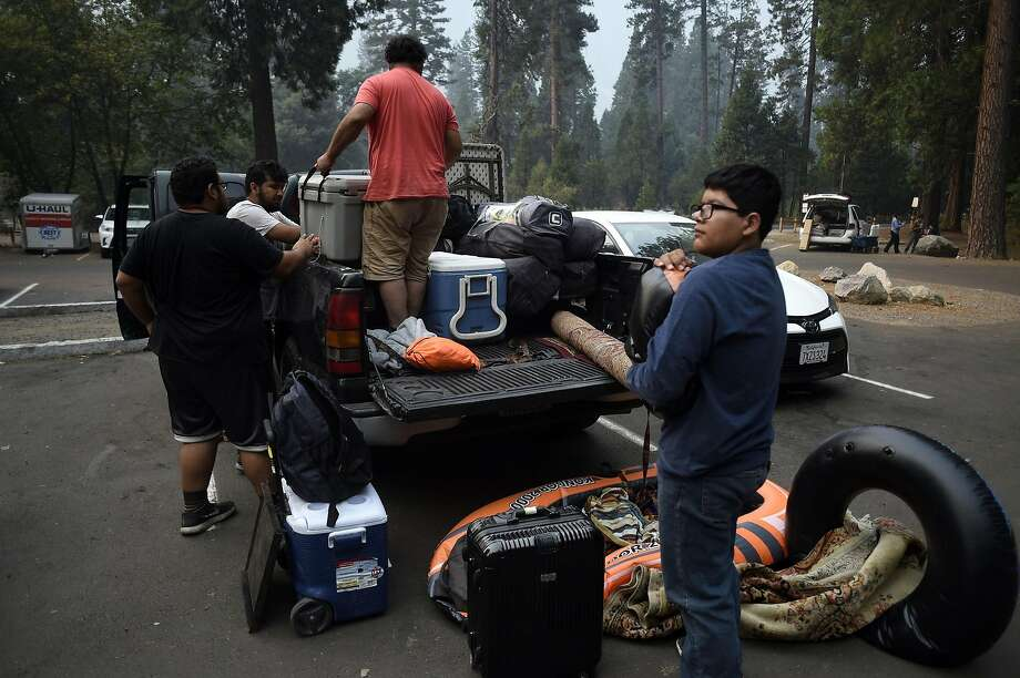 In this file photo, Marco Walker, red shirt, of Los Angeles packs up his extended family of 22, who were staying at historic Camp 4 in Yosemite National Park, on Wednesday, July 25, 2018.  Photo: Neal Waters, ZUMAPRESS.COM/TNS