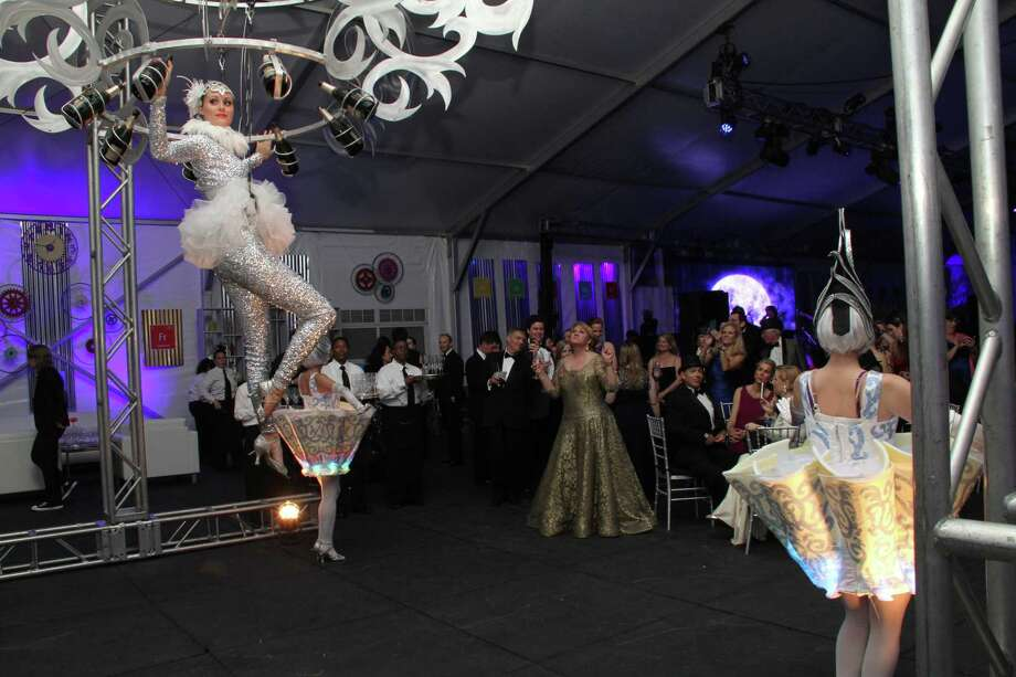 Wilkinson Rhodes event planners strives for dramatic flair at the parties it organizes, be it incorporating aerial acrobatics or other dynamic live entertainment. Photo: Wilkinson Rhodes