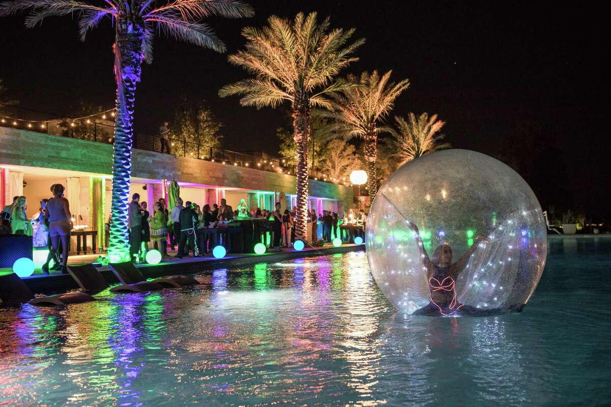 When staging higher-end parties, Goen South sees clients opt for engaging entertainment that's well outside the box, such as a contortionist in a bubble floating in a pool.