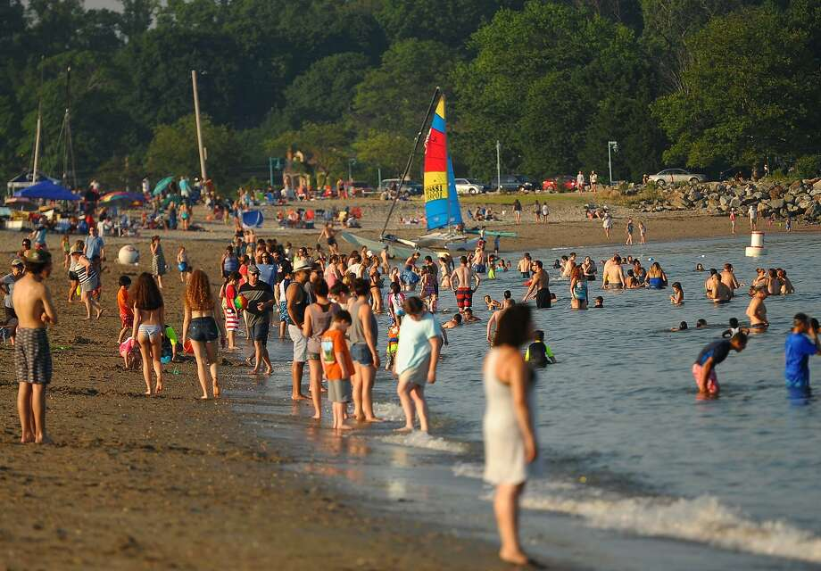 Folks keep cool with a dip in the Sound before the Fairfield Fireworks at Jennings Beach in Fairfield, Conn. on Monday, July 2, 2018. Photo: Brian A. Pounds / Hearst Connecticut Media / Connecticut Post