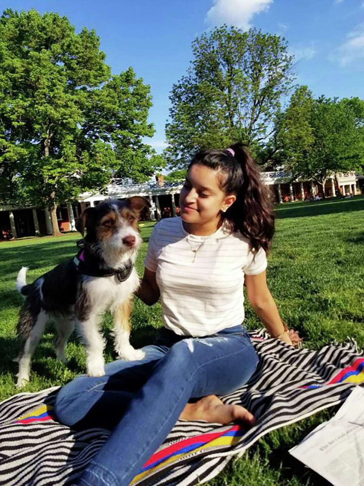 Natalie Romero relaxes with her 1-year-old dog, Luna, a Shih Tzu terrier mix, at the University of Virginia after mostly recovering from the August 2017 Charlottesville car attack.