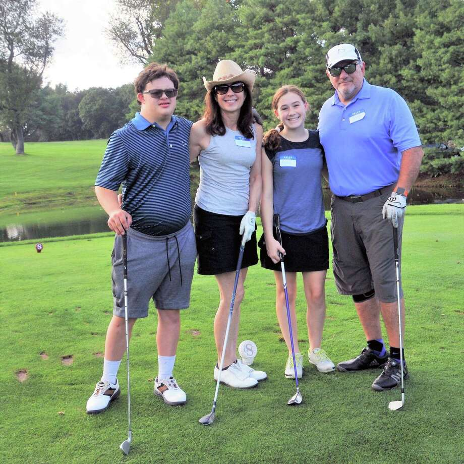 A family participates in STAR's Family & Friends Golf Tournament last year. This year's tournament will take place Sept. 15. Photo: Contributed Photo