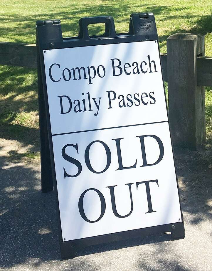 Westport's Compo Beach limited daily beach passes to 100 per day as part of a new set of beach rules implemented this summer. Photo: Contributed Photo. / Westport News
