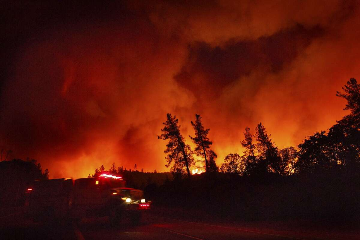 FILE - In this file photo taken Wednesday, July 25, 2018, a wildfire burns in Whiskeytown, Calif. during the Carr Fire, which was the second largest fire in the state in what became the largest fire season in California's recorded history.The number of acres burned in California through August 11, 2019 is 26 times less than the number of acres burned at the same point in 2018, according to statistics from Cal Fire.
