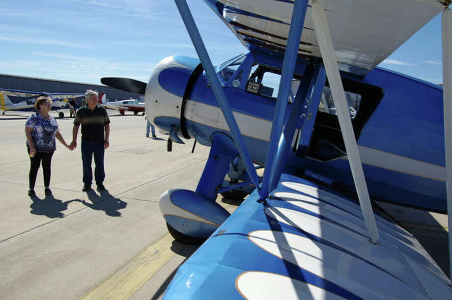 Visitors admire a 1937 Waco biplane during last year's open house at St. Louis Regional Airport in Bethalto. Photo:     David Blachette | For The Telegraph