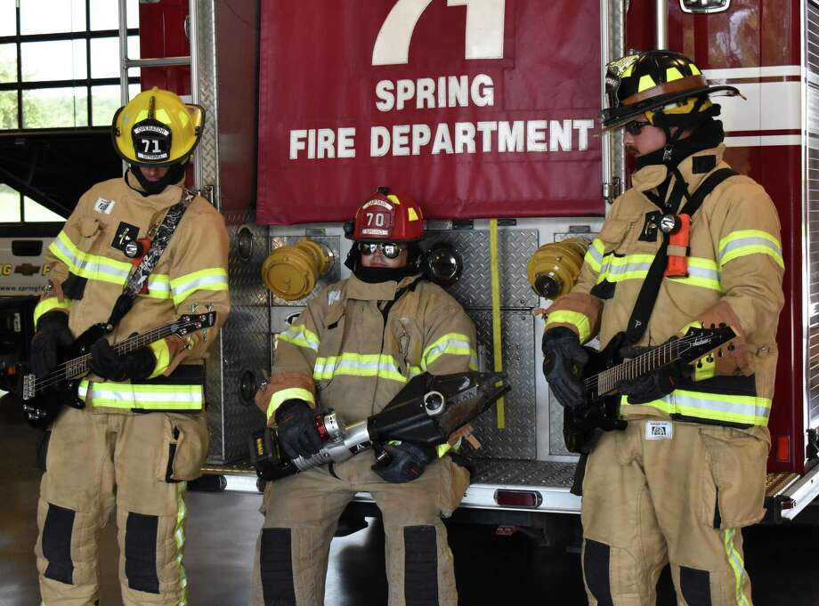 Firefighters Calvin Atkins, captain Matt Pegoda and Jeremy Cobb hold guitars to film a video highlighting the Spring Fire Department's history. Photo: Courtesy Of Hannan Falcon