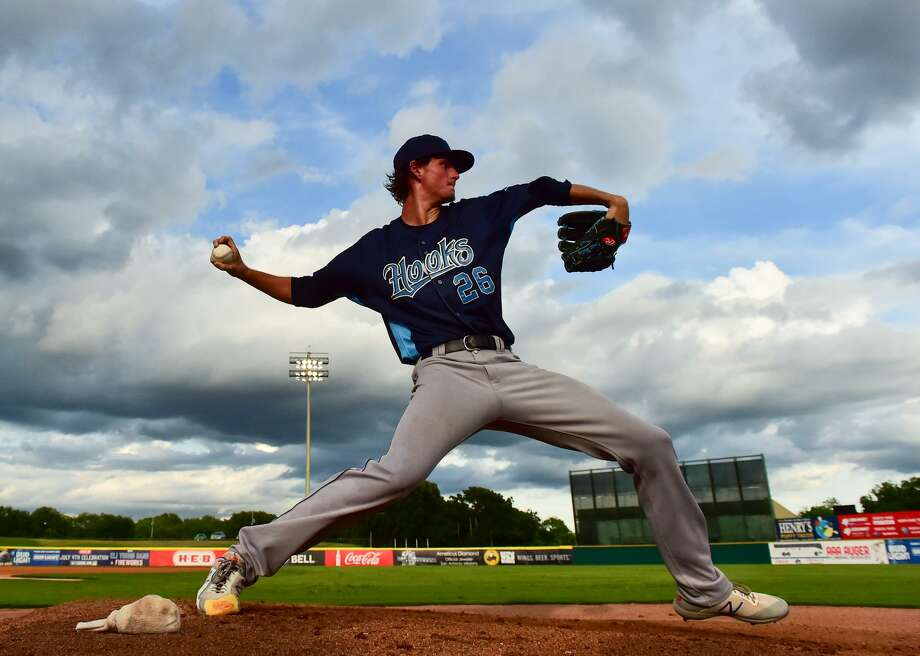 Forrest Whitley of the Corpus Christi Hooks warms up during his return to San Antonio to face the Missions Monday night Photo: Robin Jerstad /Contributor / ROBERT JERSTAD