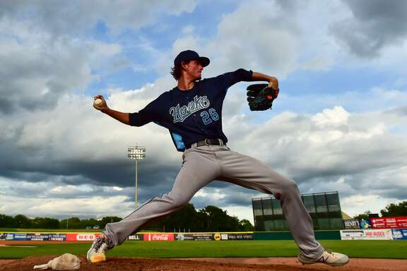 Forrest Whitley of the Corpus Christi Hooks warms up during his return to San Antonio to face the Missions Monday night