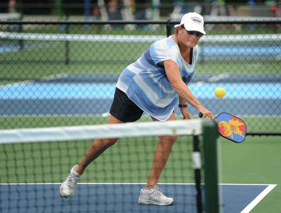 Nancy Herman, of Milford, reaches for a backhand during a game of pickleball at the new pickleball courts at Eisenhower Park in Milford, Conn. on Thursday, July 26, 2018. The courts, along with a large splash pad for children, opened to the public at the beginning of July. Photo: Brian A. Pounds, Hearst Connecticut Media / Connecticut Post