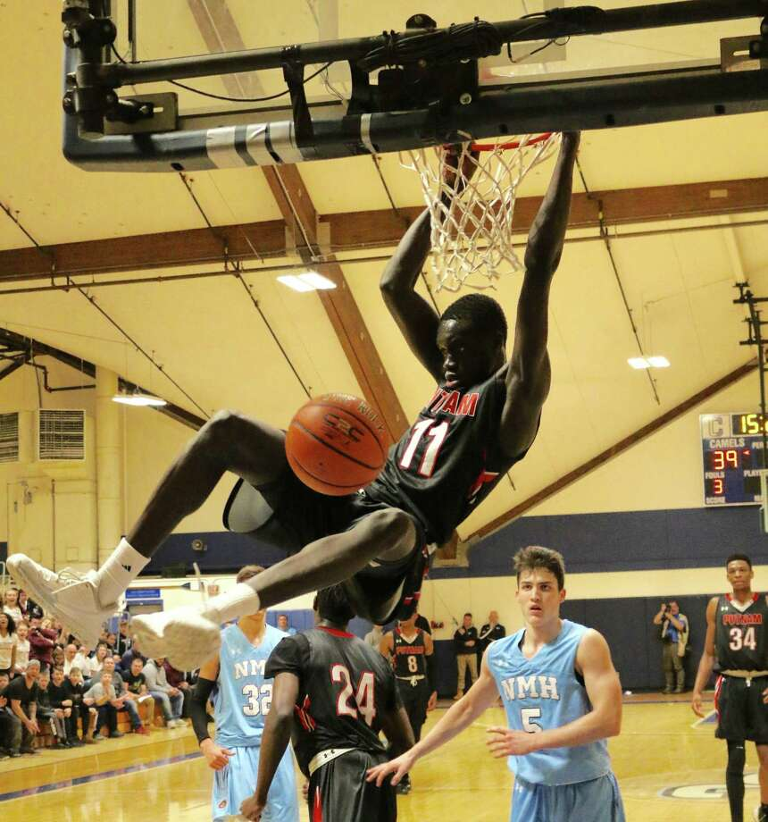 Putnam Science Academy's Akok Akok, a 6-foot-10 4-star forward, is emerging as a top prospect and drawing a lot of attention from UConn. Photo: Putnam Science Academy / Contributed Photo / Greenwich Time Contributed
