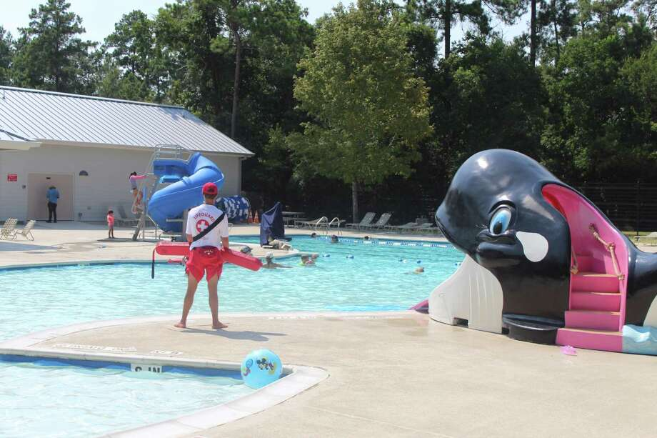 Residents of The Woodlands swim and play in the recently renovated pool at Bear Branch Park on Thursday, July 26, 2018. The pool had been closed for renovations after damage sustained during the Tax Day Floods of April 2016. Photo: Patricia Dillon / Staff Photo