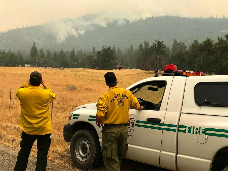 U.S. Forest Service Ranger Jason Engle (left) and Forest Service Fire Behavior Analyst Robert Scott evaluate the Ferguson Fire near Lushmeadows, Mariposa County, on Thursday. Photo: Kurtis Alexander / The Chronicle