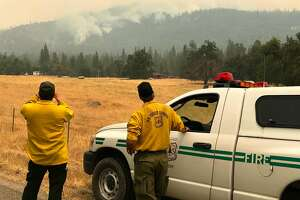 Photo 1: U.S. Forest Service Fire Behavior Analyst Robert Scott near the leading edge of the Ferguson Fire close to Lushmeadows on Thursday, July 26, 2018.Photo 2: Jason Engle, left, a U.S. Forest Service Ranger , and Forest Service Fire Behavior Analyst Robert Scott evaluate the Ferguson Fire near Lushmeadows, Mariposa County.